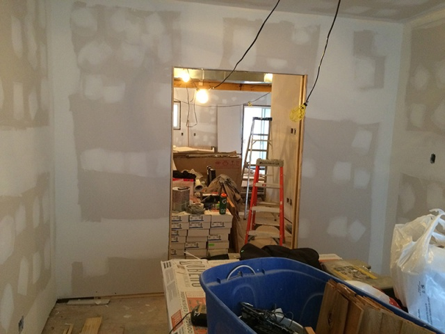 "From the office looking into the living room. Two 24"" sliding doors will fill in that large hole."