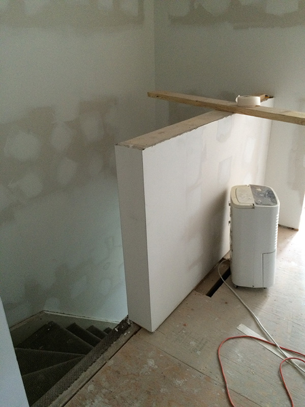 I built a half-wall at the top of the stairs. Woot!